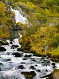 Briksdalen Waterfalls Briksdal Landscape Norway. Kleivafossen Waterfall and bridge on trail to Briksdal Glacier. Jostedalsbreen National Park, Norway stock photos