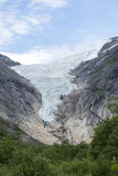 Briksdalsbreen glacier at summer in Jostedalsbreen National Park in Norway. Stock Photo