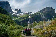 Briksdalsbreen glacier troll car excursion. Briksdal, Norway. Stock Photos