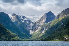 Briksdalsbreen glacier view from the fjord. Royalty Free Stock Photos