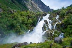 Briksdalsbreen national park waterfall. Stock Photo