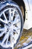 Brilho das rodas de carro da lavagem Fotografia de Stock