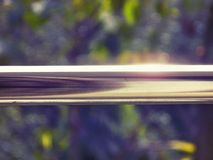 Brilho de aço dos trilhos brilhante em Sun Fotografia de Stock Royalty Free