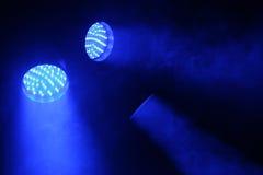 Brilho de três projectores com luz azul Foto de Stock