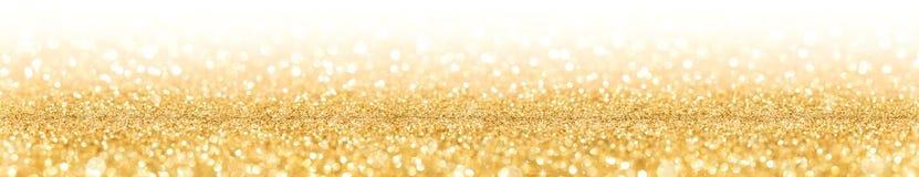 Brilho dourado com faísca das luzes Foto de Stock Royalty Free