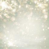 Brilho dourado do fundo do feriado do Natal abstrato Defocused Fotografia de Stock Royalty Free