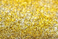 Brilho dourado e de prata imagem de stock