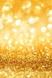 Brilho dourado e estrelas para o fundo do Natal Imagens de Stock Royalty Free