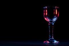 Brilhos da cor no vidro de vinho Foto de Stock