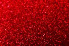 Briljant röd ljus bakgrund för en festlig garnering royaltyfri fotografi