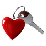 Briljante metaalsleutel met een sleutel in de vorm van een rood hart op een metaalring Royalty-vrije Stock Afbeelding