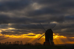 Brill mill silhouetted under dramatic skies Royalty Free Stock Photos