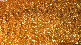 Brillant éclatant Fond sans couture miroité d'or de mouvement d'abrégé sur boucle images stock