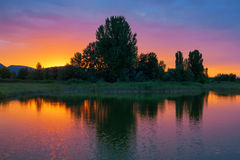 Brillant colors before dusk. Brillant colors after sunset over a lake Stock Photography