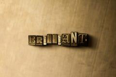 BRILLANTE - el primer del vintage sucio compuso tipo de palabra en el contexto del metal Imágenes de archivo libres de regalías