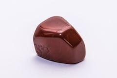 Brillante prezioso minerale della pietra preziosa del gioiello rosso scuro della gemma Immagine Stock