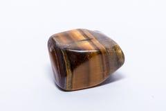 Brillante prezioso minerale della pietra preziosa di giallo dell'oro di Brown del gioiello blu della gemma Immagini Stock