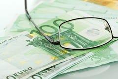 Brillen und Bargeld Lizenzfreies Stockbild