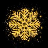 Brillez le flocon de neige d'or couvert de scintillement sur le fond noir Photo libre de droits