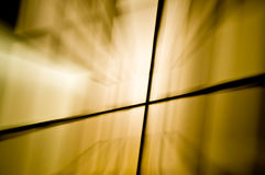 Brilliant abstract streaks of light. Brilliant streaks of light extend from around a cross shape Royalty Free Stock Photo