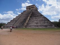 Brilliant ancient pyramid and tourists in Chichen Itza mayan town in Mexico, ruins at archaeological site stock images