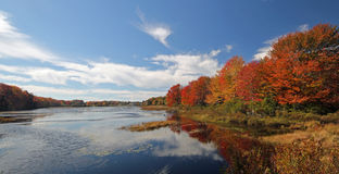 Brilliant autumn foliage at Wah-Tuh lake, Maine, New England Royalty Free Stock Images