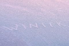 Brilliant background. White inscription. Winter patterns. Beautiful texture. Blue and white Stock Photo