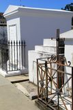 Several tombstones and heavy wrought iron gates, St. Louis Cemetery 1, New Orleans, 2016 royalty free stock photos