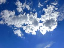 Brilliant Blue Sky. With well-defined, fluffy white clouds Royalty Free Stock Images