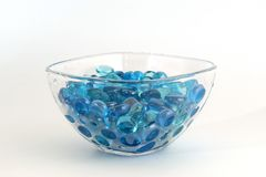 Brilliant blue stones from a glass in transparent Royalty Free Stock Photos