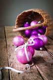 Brilliant Bright Christmas Balls from basket. On the Wooden Table Stock Image