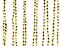 Brilliant celebratory beads of golden color Royalty Free Stock Images