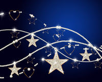 Brilliant chains with a golden stars and hearts Royalty Free Stock Photography