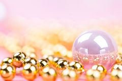 Brilliant christmas bauble and ornaments. On a pink table Royalty Free Stock Image