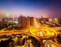 Brilliant city interchange at night. Beautiful city flyover at night , aerial view of overpass junction in guangzhou Stock Images