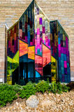 Brilliant colors of abstract art in glass windows at prairie fir Stock Photos