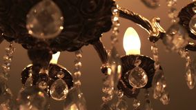 Brilliant crystal chandelier hanging on ceiling. Luxurious crystal chandelie stock video footage