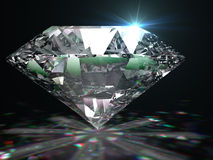 Brilliant diamond on black surface. Royalty Free Stock Photography