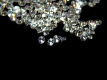 Brilliant diamonds on a black background closeup royalty free stock photography
