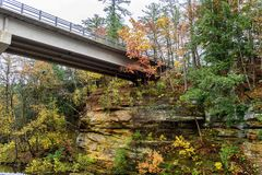 Bridge over sandstone bluffs in Wisconsin in Autumn. Brilliant fall colors and bridge over sandstone bluffs in Wisconsin Dells Royalty Free Stock Photo