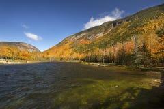 Brilliant fall foliage at Saco Lake in the White Mountains. Stock Photos