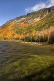 Brilliant fall foliage at Saco Lake in the White Mountains. Stock Image
