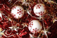 Brilliant New Year and Christmas decorations balls, tinsel and stars. Royalty Free Stock Photos