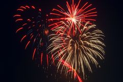 Brilliant fireworks. Fireworks display: red, white, blue bursts against a black sky Stock Photos