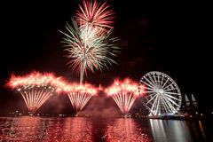 Brilliant Fireworks. Lighten up the ferris wheel and twin towers next to it Royalty Free Stock Image