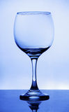 Brilliant glass with a blue background Royalty Free Stock Photography