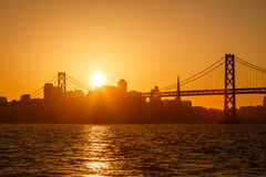 Brilliant golden glow backlights San Francisco skyline Royalty Free Stock Photos