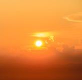 Brilliant golden sunrise over clouds Stock Photo