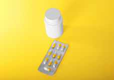 Brilliant and gray packaging of antibiotics in capsules and a white bottle for pills, painkillers, vitamins and medicines. Close-up various colorful prescripted Royalty Free Stock Images