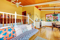 Brilliant guest house with yellow interior. Royalty Free Stock Photos